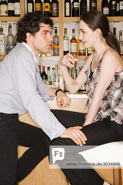 Young couple in a wine bar