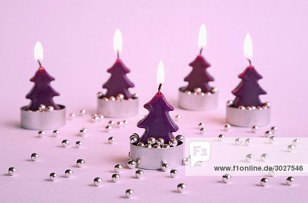 Burning candles  Christmastree-shaped