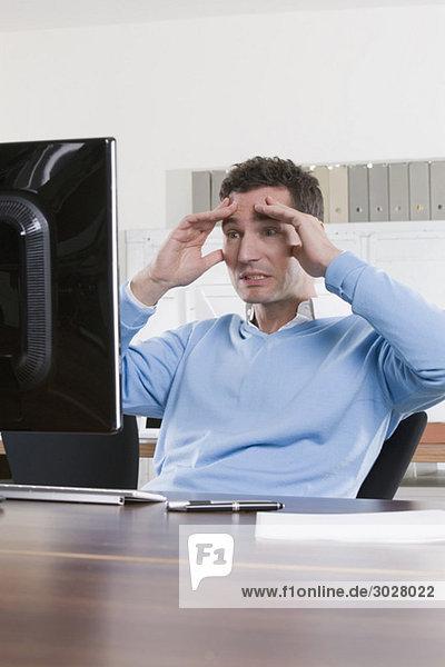 business man in office  hands on head  portrait