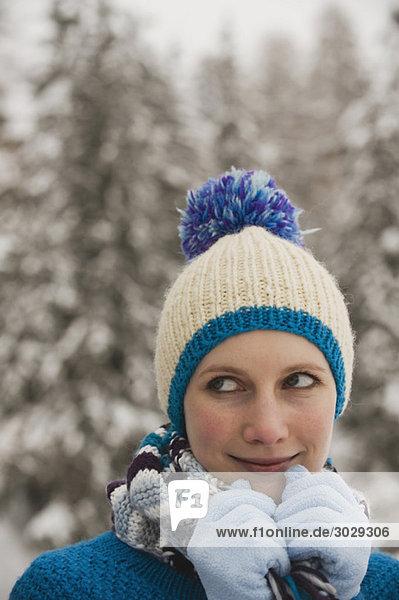 Italy  South Tyrol  woman wearing bobble cap  portrait