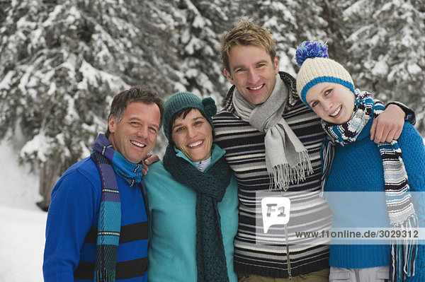 Italy  South Tyrol  Young people in winter clothes  arm in arm  portrait