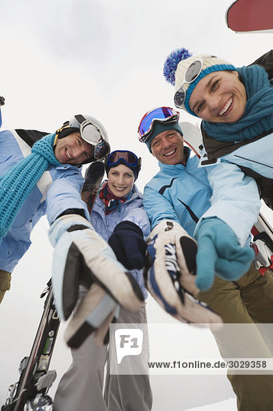 Italy  South Tyrol  Young people in winter clothes  low angle view