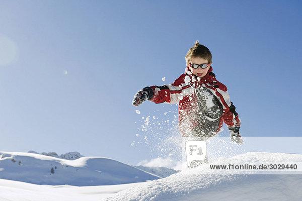 Italy  South Tyrol  Seiseralm  Boy (4-5) playing in snow