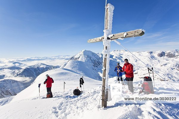 Headline: Three climber on a mountaintop  Salzburger Land  Austria