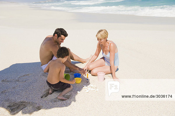 Family playing on the beach