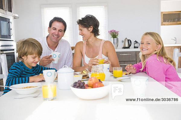 Family having breakfast at the dining table