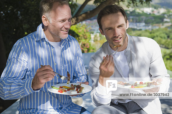 Two friends eating fruit salad