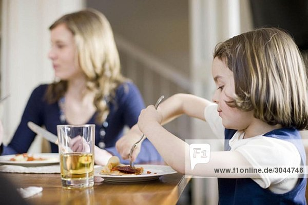 girl and younger sister eating