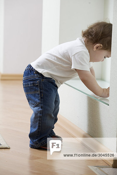young boy starting to walk at home