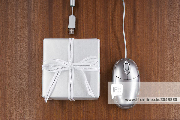 still life of computer mouse and present
