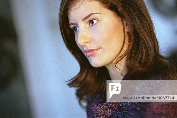 Young businesswoman looking away in thought  portrait