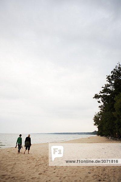Two women walking on the beach Sweden.