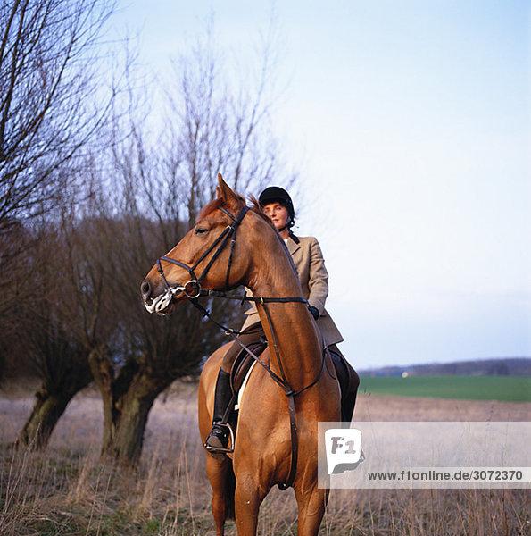 A woman riding a horse Skane Sweden