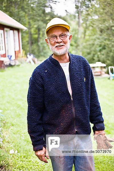 Elderly man with red paint on his clothes Sweden