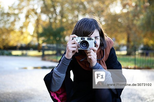 A woman taking a picture London Great Britain.
