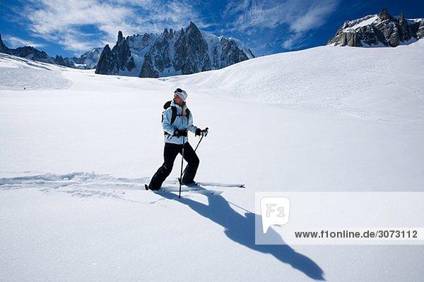 Skier going downhill Chamonix France.