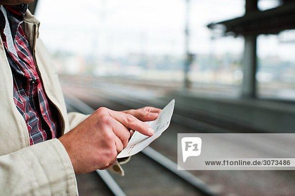 A man at a platform of a railway station Sweden.