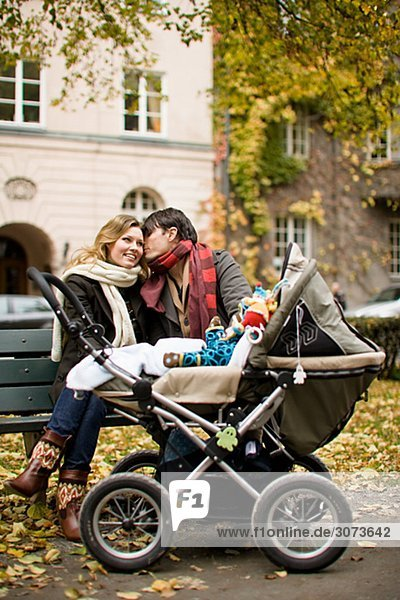 A smiling couple and their son Sweden.