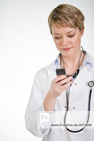 A female doctor using a mobile phone Sweden.