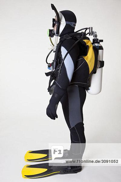 Portrait of scuba diver  side view  studio shot