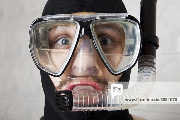 A wearing a scuba mask half full of water