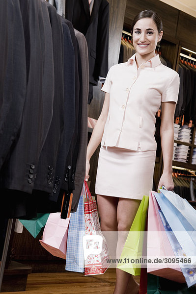 Woman holding shopping bags in a clothing store