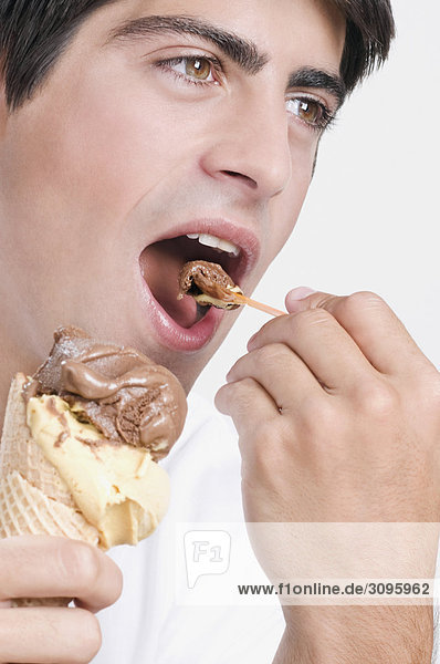 Close-up of a man eating an ice cream