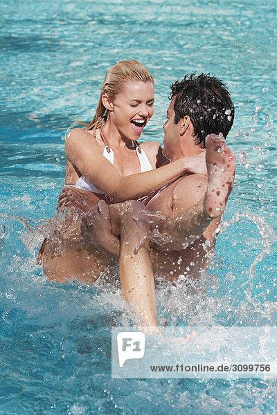 Couple having fun in a swimming pool  Biltmore Hotel  Coral Gables  Florida  USA