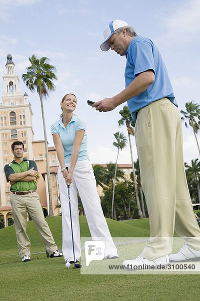 Three golfer standing in a golf course  Biltmore Golf Course  Biltmore Hotel  Coral Gables  Florida  USA