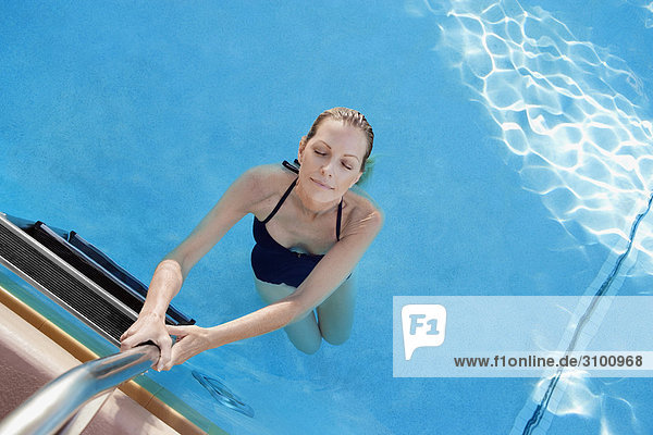 Portrait of a woman in a swimming pool  Biltmore Hotel  Coral Gables  Florida  USA