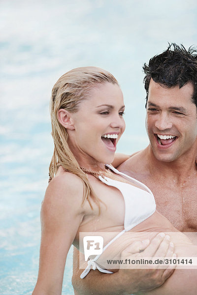 Couple romancing in a swimming pool  Biltmore Hotel  Coral Gables  Florida  USA