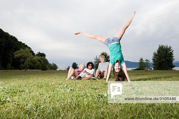 Teenage girl going handstand