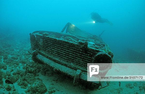 Scuba diver and car wreck  Croatia  Istria  Mediterranean Sea  underwater shot
