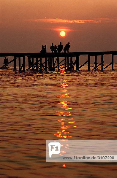 Sunset over jetty  Sipadan  Malaysia  silhouette