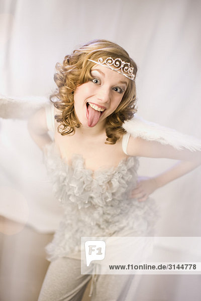 girl dressed as a angel with tongue out