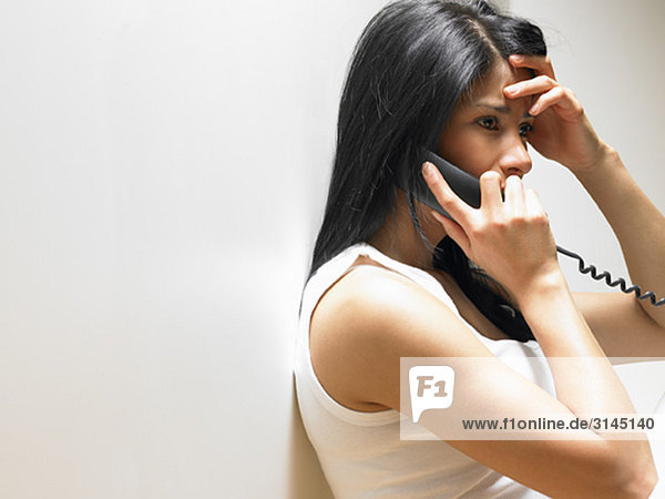 Woman on the phone  anxious