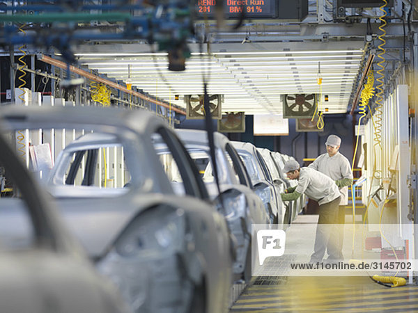 Car Plant Workers On Production Line