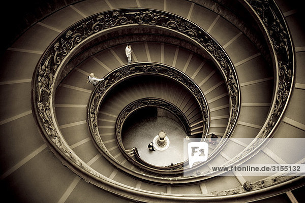 Spiral staircase by Giuseppe Momo leading to main floor of Vatican Museum  Vatican City  Rome