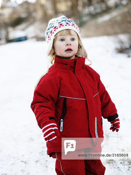 A girl playing in the snow Sweden.