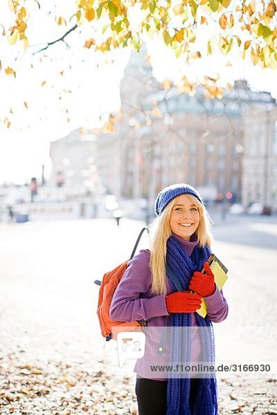 Young female student taking a walk in autumn Stockholm Sweden.