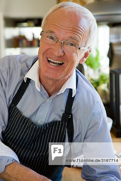 Senior man cooking  Sweden.