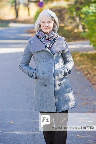 Portrait of a senior woman taking a walk  Sweden.
