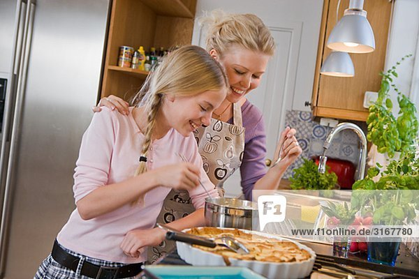 Mother and daughter with a freshly baked pie  Sweden.