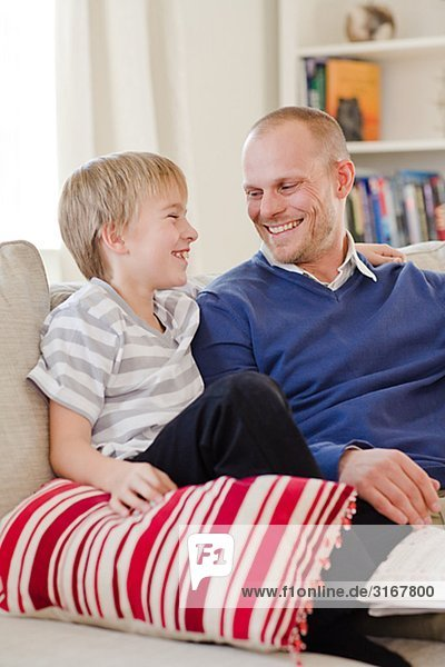 Father and son in a couch  Sweden.