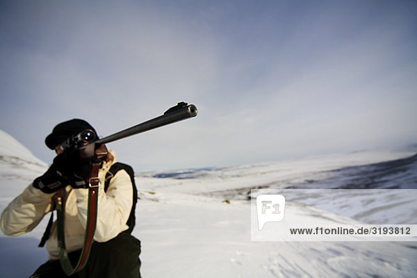 A hunter on a grouse-shooting expedition in the north of Sweden.