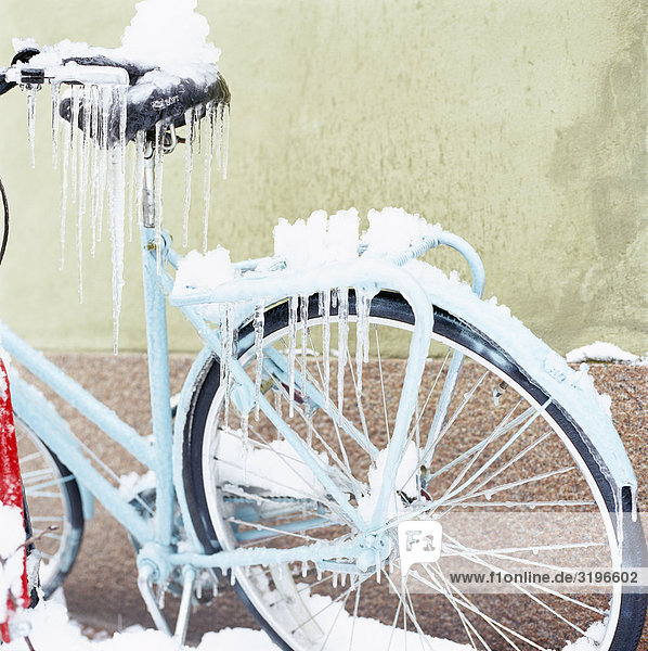 A bicycle covered with ice.