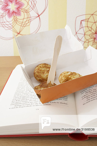 box with little pancakes on book