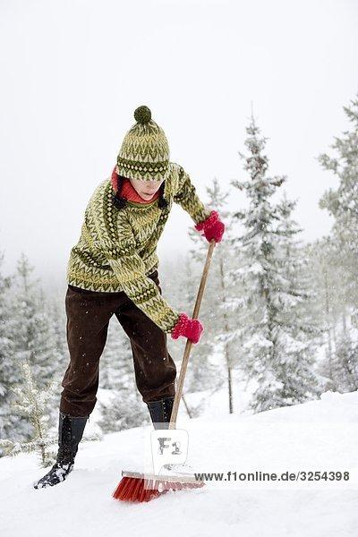 Eine Frau auf Ski-Urlaub  Schweden.