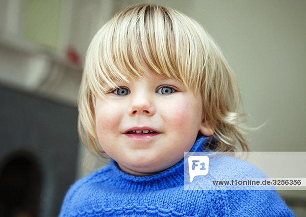 A boy toddler smiling to camera
