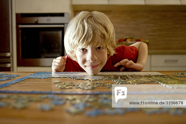 Portrait of a boy with a puzzle